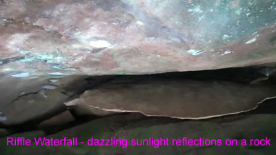 video clip of the sun and water reflections on a rock at the Riffle Waterfall in Millwood WV